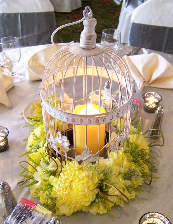 Gorgeous Floral And Candle Accented Wedding Birdcage Centerpiece