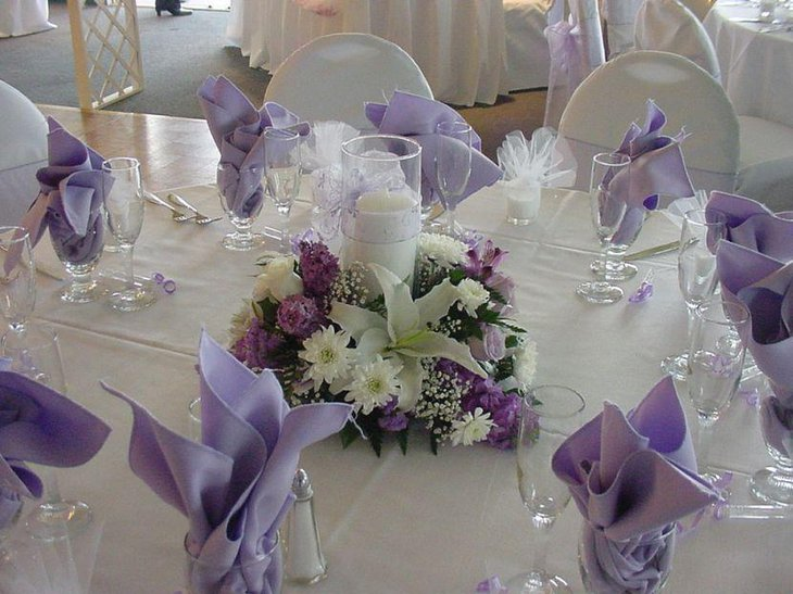 Stunning Purple And White Floral Candle Centerpiece For Wedding Table